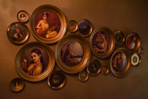 Paintings from old that adorn the walls at The Awadh House